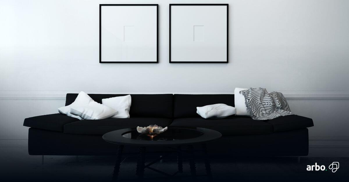 sala decorada com sofá preto fosco